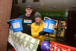 two men holding buckets and raising money for the Syrian Crisis Appeal