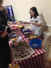 Eden at the bake sale, selling out fast!