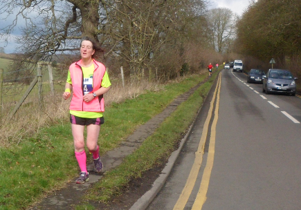 Woman running the Berkhamsted Half Marathon.