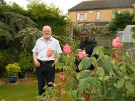 Frank shows Sheku (Sierra Leone) his garden