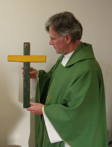 Fr John Danford with the Lampedusa Cross