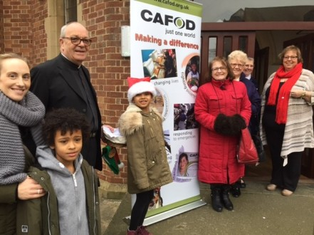 Singing carols outside the church