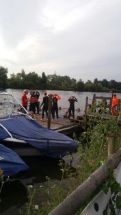 Minutes before the start of the race, preparing to enter the open lake.