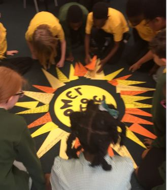 Year 5 pupils constructing their big Sunray display of messages