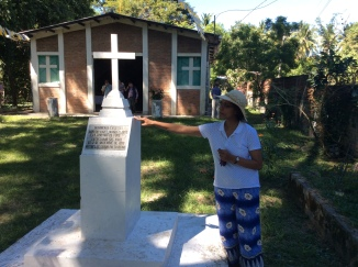Debbie standing at the memorial monument for the women, erected in the place where their bodies were found. Here, she is shown saying a prayer for them and all those going through persecution.